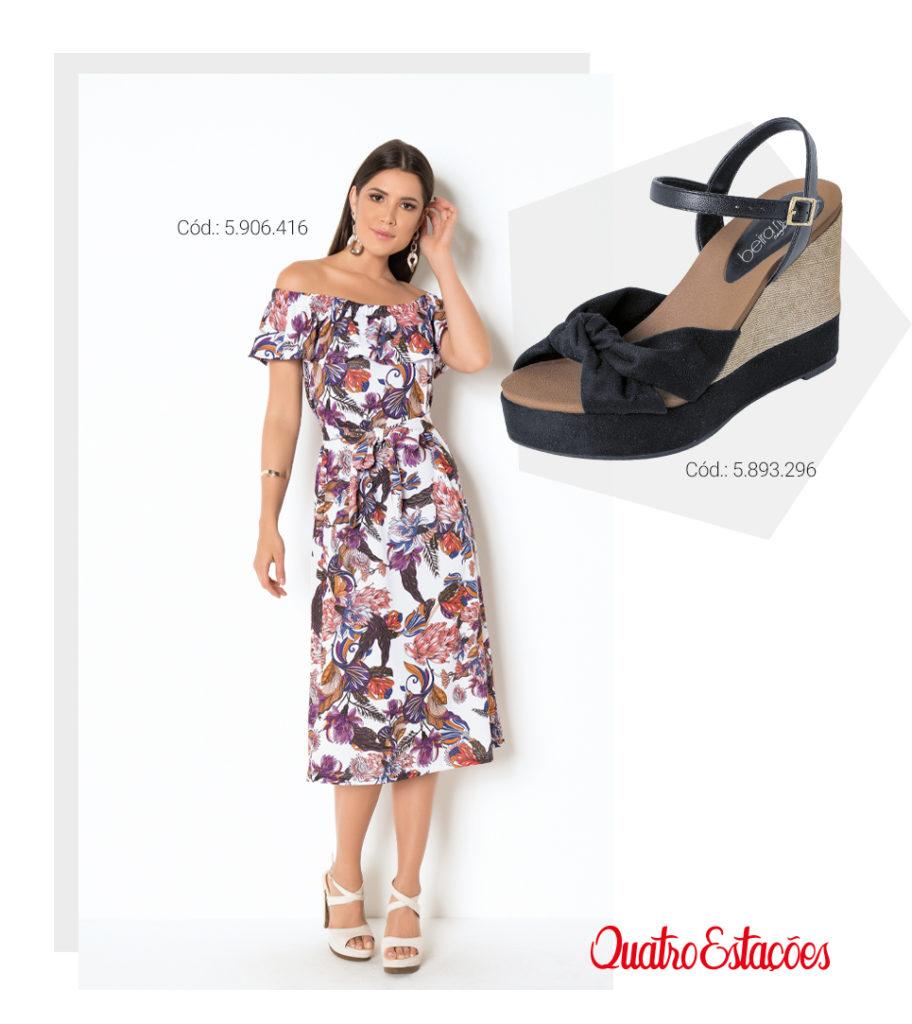 Modelo usando um vestido mídi com estampa de folhagens, modelo ciganinha. Sugestão de combinação com sandália anabela preta.